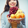 Woman with tropic fruits — Stock Photo