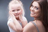 Girl with mother — Stock Photo
