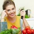 Stock Photo: Woman cooking healthy food