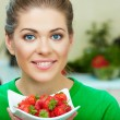 Woman eating strawberry — Stock Photo #36181187