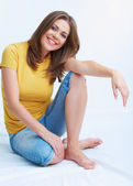 Woman seating on floor — Stock Photo