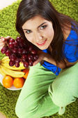 Woman with tropical fruits — Stock Photo