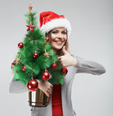 Woman in santa hat — 图库照片