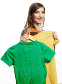 Woman holding casual clothes. — Stock Photo