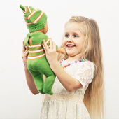 Girl play with doll — Stock Photo