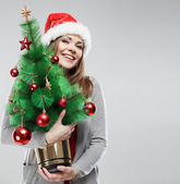 Woman in santa hat — Stockfoto