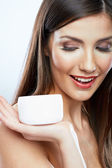 Woman hold cosmetic cream — Stock Photo