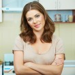 Woman in kitchen — Stock Photo #36580575