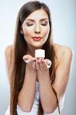 Woman hold cosmetic cream — Photo