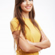 Young casual woman in yellow t-shirt — Stock Photo #37943681