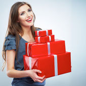 Young happy smiling woman holding red gift boxes — Stock Photo