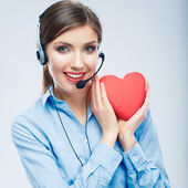 Woman call center operator hold love symbol of Valentine day — Stock Photo