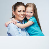 Mother and daughter embrace. — Stock Photo