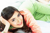 Bed time smiling woman portrait. — Stock Photo