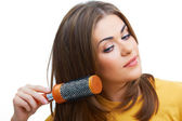 Woman comb hair — Stockfoto