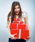 Happy smiling woman holding red gift boxes. — Stock Photo