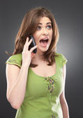 Angry woman shouts in phone — Stock Photo