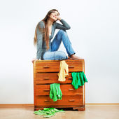 Girl with cupboard — Stock Photo