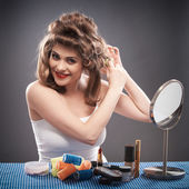 Woman making hairstyle — Stock Photo