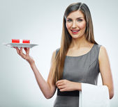Young business woman with gift on a plate. — Stock Photo