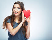 Beautiful woman hold Valentine day symbol — Stock Photo