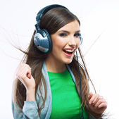 Young motion woman with headphones listening music — Stock Photo