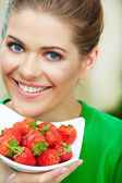 Woman sting strawberry — Stock Photo