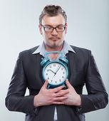 Business man hold clock — Stock Photo