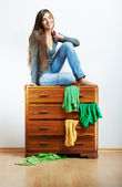 Woman on cupboard — Stock Photo