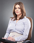 Business woman sitting in chair — Stock Photo