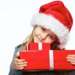 Little girl hold gift box. White background. — Stock Photo