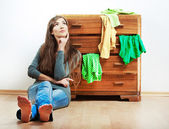 Woman and cupboard — Stock Photo