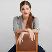 Woman sitting on chair — Photo