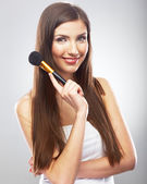 Young beautiful woman with make up brush. — Stock Photo
