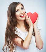 Beautiful happy woman hold Valentine day symbol. — Stock Photo
