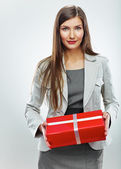 Business woman hold gift — Stock Photo