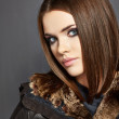 Young woman in fur leather coat leather. — Stock Photo