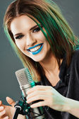 Beautiful young woman singer. — Stock Photo