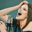 Постер, плакат: Woman singer with microphone