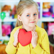 Stock Photo: Girl hold heart