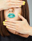 Woman face. Yellow nail. Blue lips. — Stock Photo
