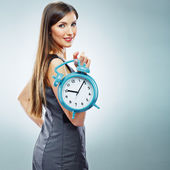 Business woman holding watch — Stock Photo