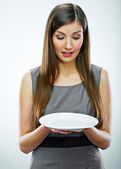 Woman hold empty white plate. — Stock Photo