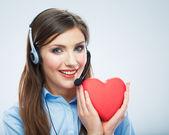 Woman call center operator hold heart — Stock Photo