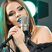 Woman with microphone — Stock Photo
