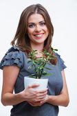 Woman holds houseplant — Stock Photo
