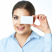 Woman holds card near eyes — Stock Photo