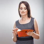 Woman holds card and purse — Stock Photo