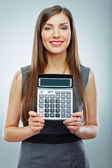 Woman holds calculator — Stockfoto