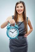 Business woman holding watch — Stock Photo